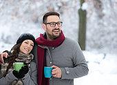 Couple drinking tea on snow