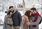 Couples walking in park on snow