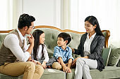 asian parents and children chatting at home