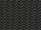 Abstract of white zig zag pattern on black background.