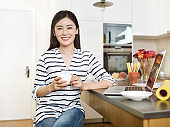 young asian woman working at home