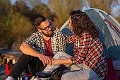 Couple camping at the lake