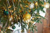 Christmas tree branches balls decoration New Year with bokeh lights on background