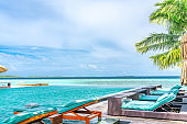 Tanning Beds Beside Swimming Pool in Tropical Resort in Maldives