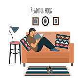 Reading guy at home on sofa. Man sitting on couch with interesting book. Vector flat illustration isolated on white background.