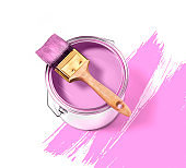 Pink paint tin can with brush on top on a white background with pink strokes