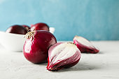 Flat lay composition with red onion on light background, space for text