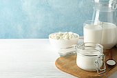 Fresh dairy products on white wooden table, copy space