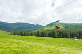 People in the cable car exploring the surroundings from the Carpathian Mountains