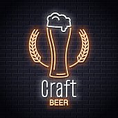 Beer glass with wheat neon logo. Craft brewery neon sign on wall background