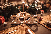 decorated christmas table with new year 2020 numbers