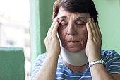 Senior woman with neck injury