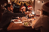 people have fun at dinner for christmas