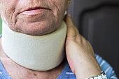 Senior woman wearing neck brace