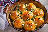 Garlic bread, buns. Bread rolls with garlic and parsley.