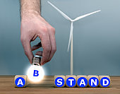 """Symbol for a minimum distance between a wind turbine and residential areas. Dice form the German word """"Abstand"""" (""""distance"""" in English)."""