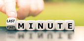 """Hand turns a dice and changes the expression """"first minute"""" to """"last minute""""."""