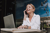 Cropped photo of happy businesswoman with closed eyes talking on smartphone