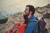 Positive tourists hugging near the sea