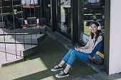 Asian beautiful girl in headphones relaxing indoors