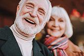 Senior bearded man feeling joy while spending time with wife