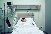 Asian woman having an iv drip at hospital