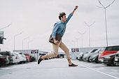Happy man having fun on the parking lot