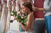 Hair style for happy bride in wedding dress