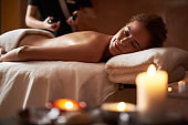 Young smiling lady relaxing on massage table