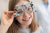 Cute little girl wearing optical trial frame
