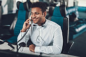 Male dispatcher talking by phone on work place