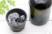 Bottle of Japanese shochu and ceramic bowl