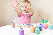 Little Child Draws Painted Hands in Paint. Painting. Development and Training