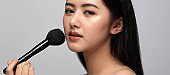 Beautiful young asian woman clean fresh bare skin concept. Asian girl beauty face skincare and health wellness, Facial treatment, Perfect skin, Natural make up isolated on gray background