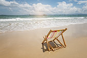 Sea beach sand with wave with Deck chair