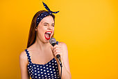 Close-up portrait of her she nice attractive lovely crazy girlish positive cheerful cheery straight-haired girl artist singing new popular melody isolated on bright vivid shine yellow background
