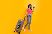 Full length body size portrait charming positive cheerful lady hold hand want weekend move customs check denim jeans trendy stylish red striped t-shirt spectacles she her isolated yellow background