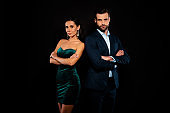 Close up photo amazing colleagues pair she her chic he him his macho stand back to back arms crossed best partnership wear blue costume jacket green glossy velvet dress isolated black background