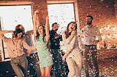 Close up photo yelling loud friends event hang out dancing drunk birthday sing singer hands arms raised up she her ladies he him his guys wear dress shirts formal wear glitter loft room indoors
