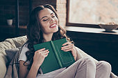 Close up photo beautiful brunette she her lady imagination flight relaxing covered blanket read favorite adventure plot part chapter wearing domestic home apparel clothes outfit sit comfy arm-chair