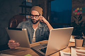 Photo of attentive guy work at dark day time reading report using e-book wear casual outfit sit modern office