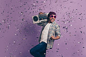 Closeup photo portrait of mad screaming shouting cool modern swag student millennial enjoying nice holiday festival holding cassette player make noise loud sound isolated violet background