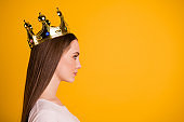 Close up side profile photo beautiful amazing she her lady leader chief gold crown head coronation nomination special social status star wear casual pastel t-shirt isolated yellow bright background