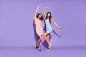 Full length body size photo two stunning she her ladies funny funky prom night dance like last time scream shout yell songs wear festive dresses isolated purple violet vivid vibrant background
