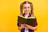 Closeup photo of small lady knowledge wondered reading story wear specs checkered shirt isolated bright yellow background