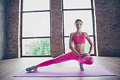 Portrait of nice attractive graceful charming thin shape form line bendy flexible lady wearing pink clothes top doing work out in modern loft industrial interior style