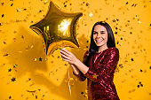 Close-up portrait of her she nice-looking attractive lovely gorgeous fascinating cheerful girl holding in hands air ball celebratory isolated on bright vivid shine vibrant yellow color background