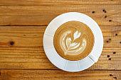Cup of coffee with latte art pattern milk foam