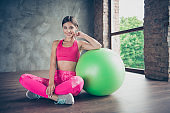 Portrait of her she nice cute graceful slender beautiful attractive stunning cheerful lady wearing pink outfit look leaning on green fit-ball enjoy free time in modern loft industrial interior style