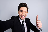 Close up photo amazing he him his macho handsome make take selfies thumb raised up advising buy buyer product funny funky wear white shirt black suit jacket tie formalwear isolated grey background
